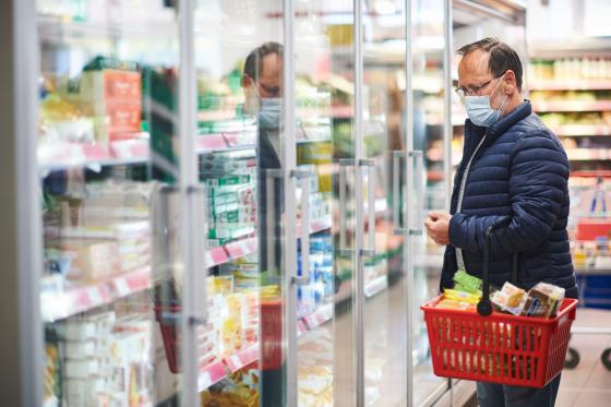 Man grocery shopping mask shutterstock Anna Nahabed